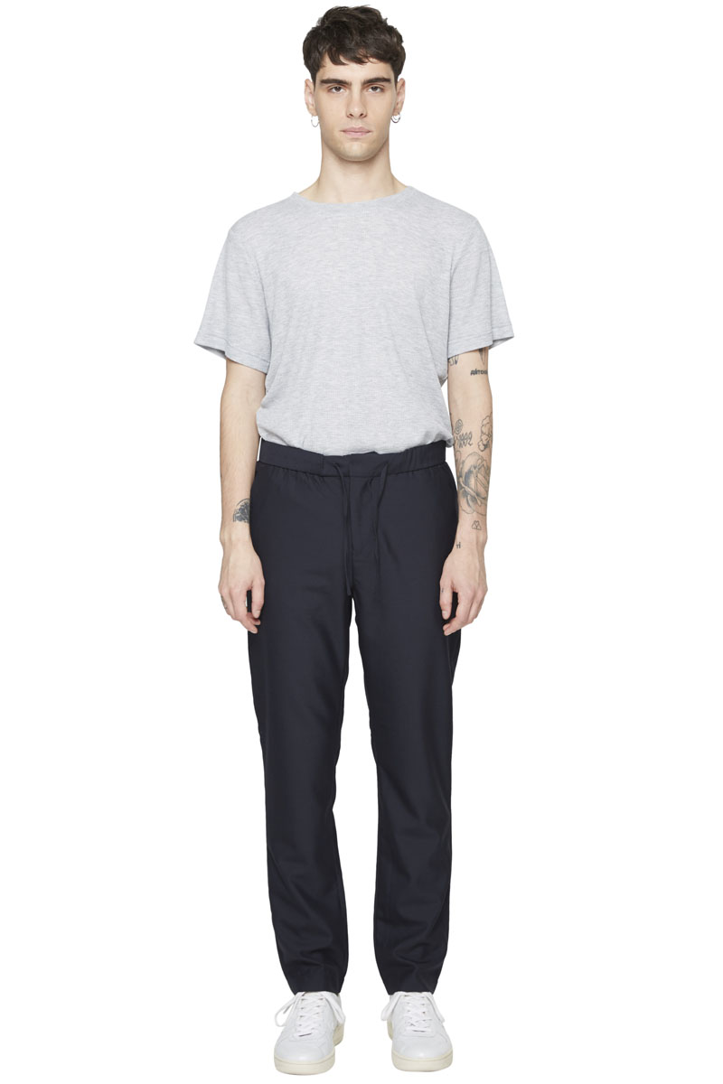 - Wool trouser - Slight carotte fit - Flat drawcord at the