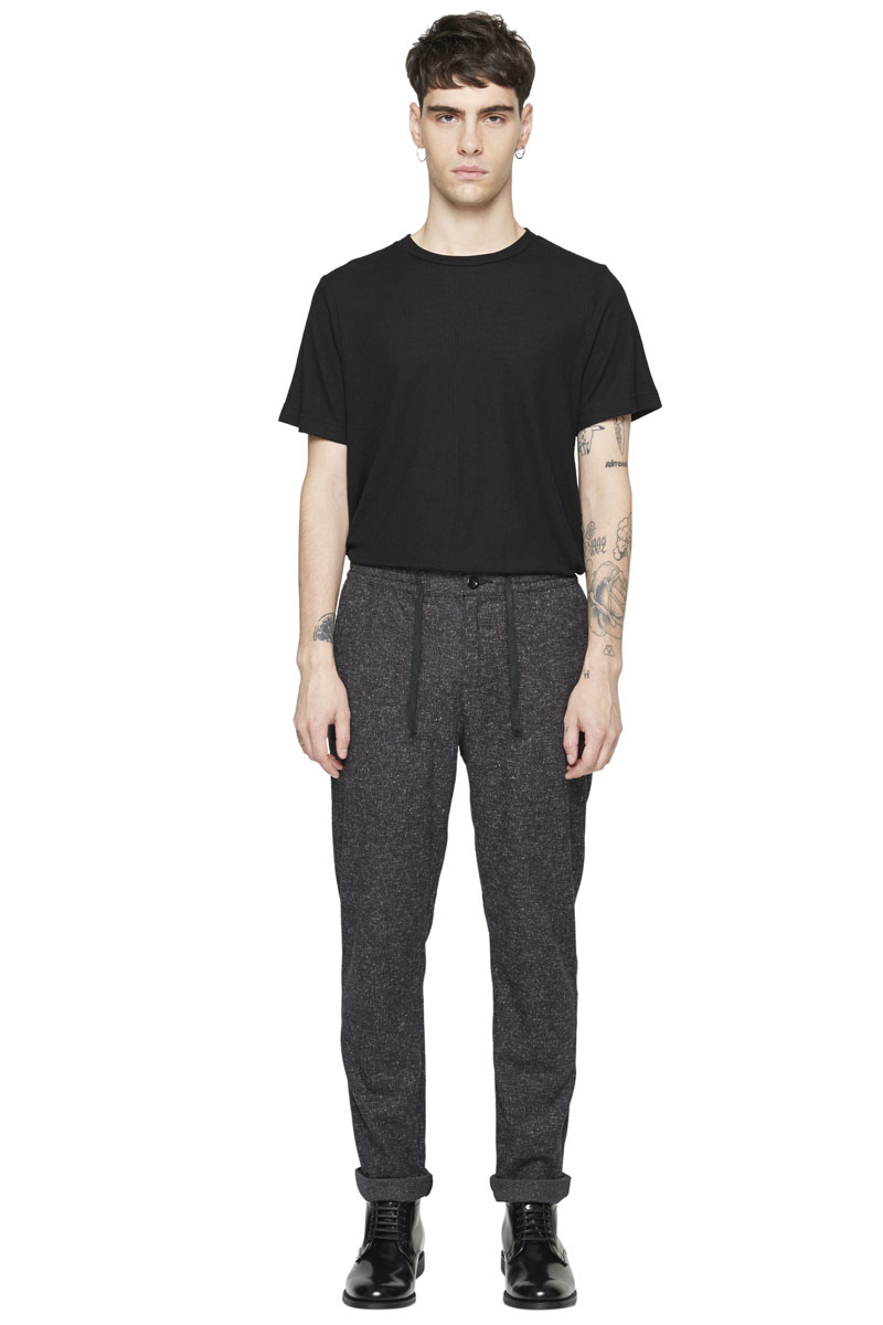 - Polyester and rayon trouser - Slight carotte fit - Elastic