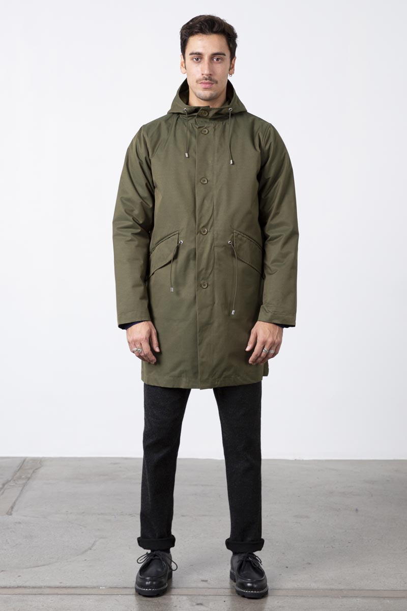 Classic clean look hooded two pocket rain parka with a