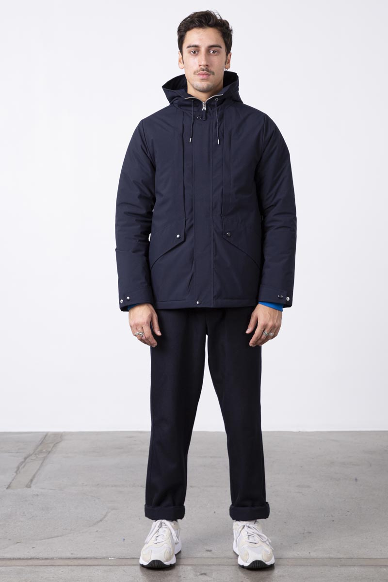 Short hooded jacket parka. Constructed from a water and wind