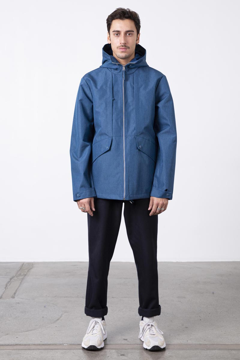 Short hooded jacket inspired by trek jackets. Multiple front