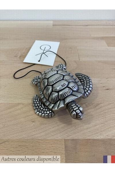 Boucle tortue<p> Matière : métal<p> Couleur : argent<p>