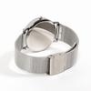 Cadran métal chromé. Bracelet maille milanaise. Mouvement à
