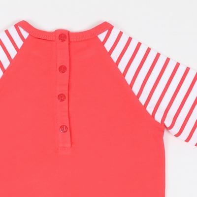 Tunique manches longues en jersey coton élasthanne. Encolure
