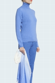 100% Cashmere turtle neck sweater. Single ply, slightly