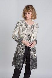 Printed cashmere macramé coat. Black and white floral print