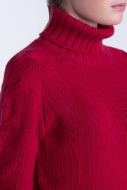 100% Cashmere cable turtle neck sweater. 2-ply, slightly