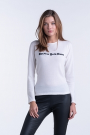 100% cashmere woman boat neck sweater. Hand-intarsia work