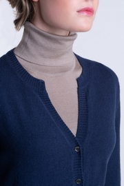 2-Ply, 100% Cashmere woman crew neck cardigan. Solid style,