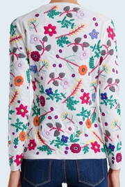 100% Cashmere allover floral embroidered crew neck. Fitted