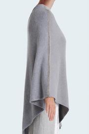 Poncho Femme bicolore en maille 100% cachemire. Taille