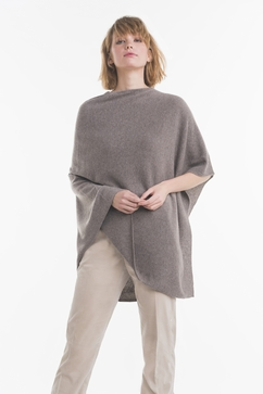 Single Ply knitted cashmere poncho with side ribs. One size