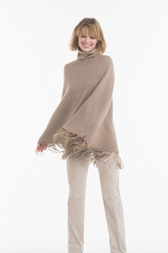 Two-Ply knitted cashmere poncho with fringes. One size only.