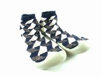 la paire de chaussures pijama de collegien présentée ici